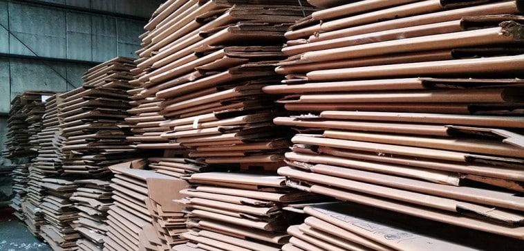 Large stacks of broken down cardboard boxes.