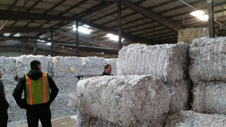 Large bales of shredded paper recycled material.