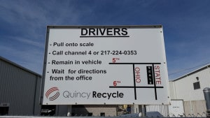 Exterior view of a Quincy Recycle facility with various signage to help direct drivers arriving to the facility.
