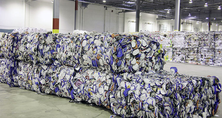Large bales of recycled material inside a Quincy Recycle facility.
