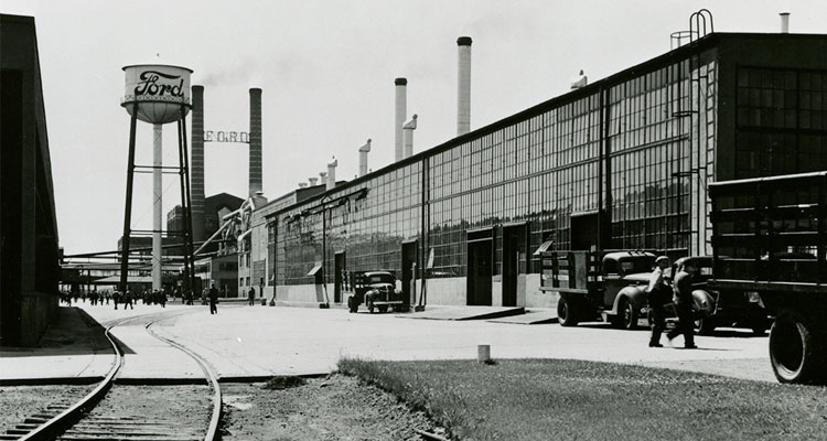 Exterior historical view of a Ford manufacturing facility.