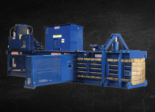 Large blue auto-tie baling machines used for processing recycled materials.
