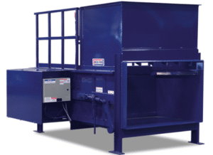 Large blue compactor used for processing recycled materials.