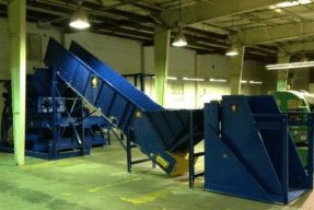 Large blue conveyors used for processing recycled materials.