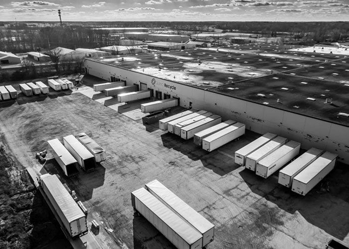 Aerial view of a large Quincy Recycle location with several trailers parked at loading docks.