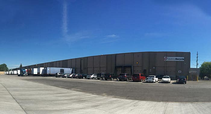 Large brown building with shipping and receiving docks at Quincy Recycle location in Chicago, IL